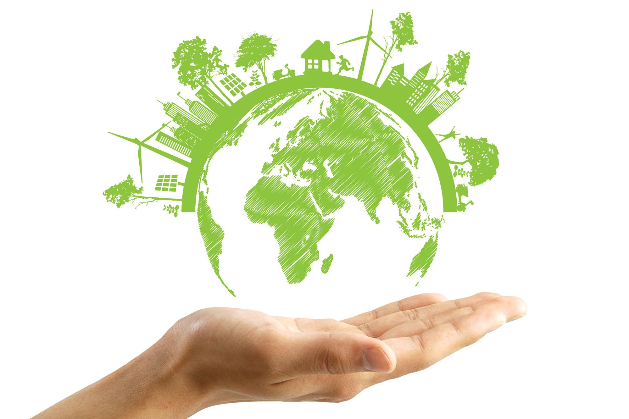Hand mit grüner Erde